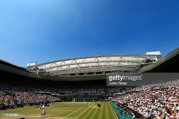 Novak Djokovic of Serbia serves on Centre Court during the Gentlemen's Singles Final match against Andy Murray of Great Britain on day thirteen of...