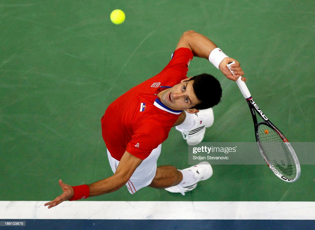<a gi-track='captionPersonalityLinkClicked' href=/galleries/search?phrase=Novak+Djokovic&family=editorial&specificpeople=588315 ng-click='$event.stopPropagation()'>Novak Djokovic</a> of Serbia serves the ball to Radek Stepanek of Czech Republic during the day one of the final Davis Cup match between Serbia and Czech Republic at Kombank Arena on November 15, 2013 in Belgrade, Serbia.