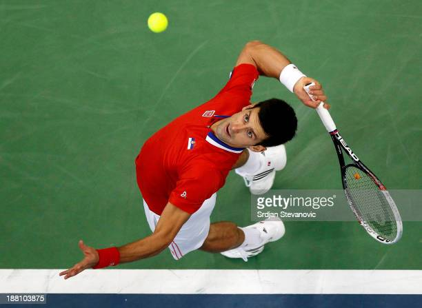 Novak Djokovic of Serbia serves the ball to Radek Stepanek of Czech Republic during the day one of the final Davis Cup match between Serbia and Czech...