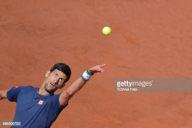 Novak Djokovic of Serbia serves to Alexander Zverev of Germany during the ATP Tennis Open final at the Foro Italico on May 21 2017 in Rome / AFP...