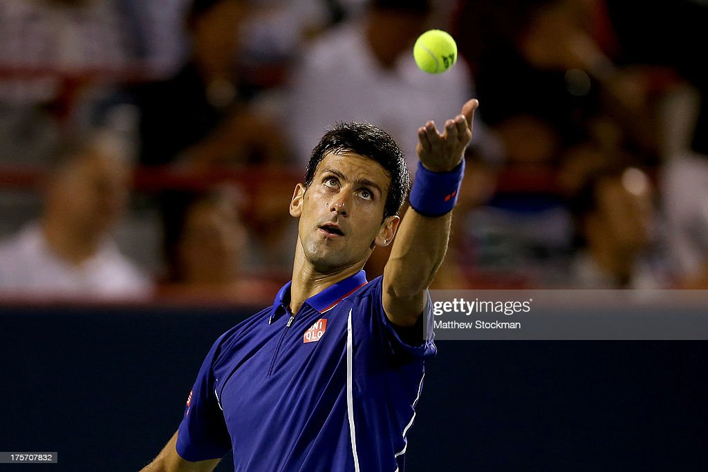 <a gi-track='captionPersonalityLinkClicked' href=/galleries/search?phrase=Novak+Djokovic&family=editorial&specificpeople=588315 ng-click='$event.stopPropagation()'>Novak Djokovic</a> of Serbia serves to Florian Mayer of Germany during the Rogers Cup at Uniprix Stadium on August 6, 2013 in Montreal, Quebec, Canada.