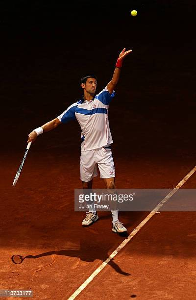 Novak Djokovic of Serbia serves to Guillermo GarciaLopez of Spain during day six of the Mutua Madrilena Madrid Open Tennis on May 5 2011 in Madrid...
