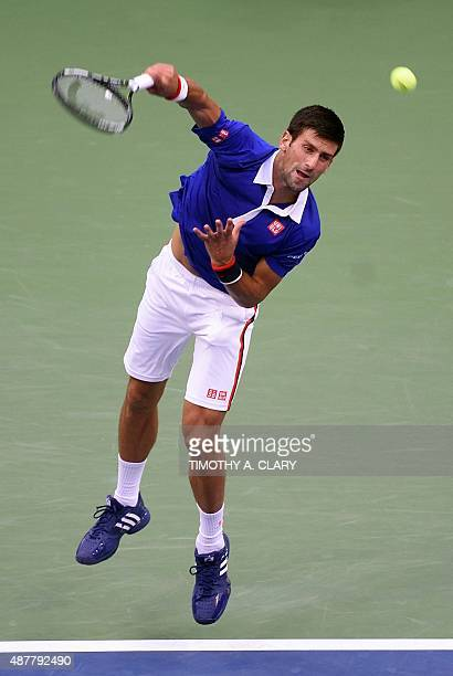 Novak Djokovic of Serbia serves to Marin Cilic of Croatia during their 2015 US Open Men's Singles semifinals match at the USTA Billie Jean King...