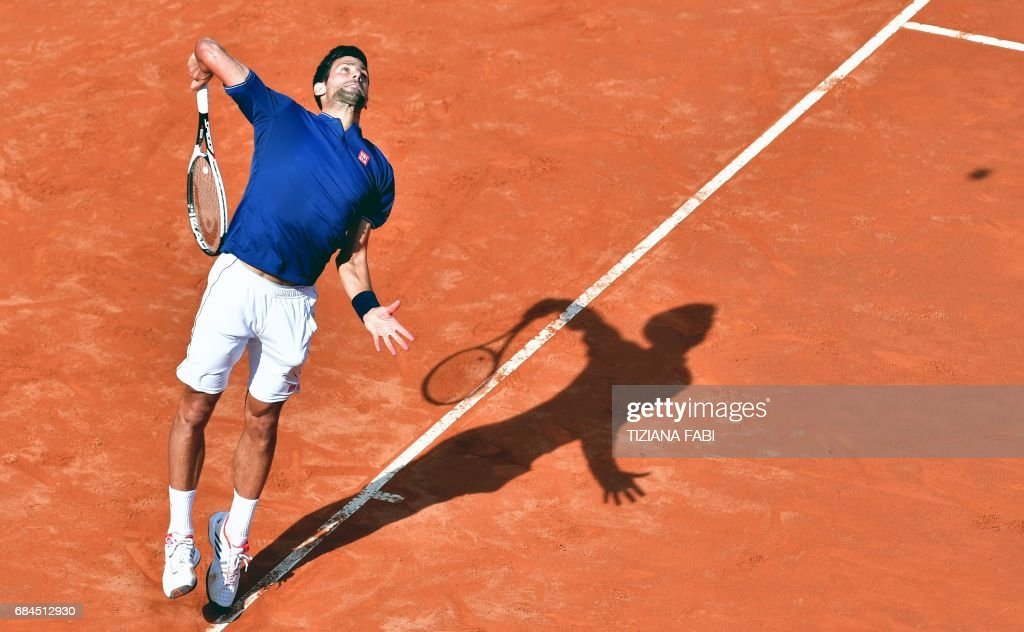 TOPSHOT - Novak Djokovic of Serbia serves to Roberto Bautista during their third round match at the ATP Tennis Open tournament on May 18, 2017 at the Foro Italico in Rome, Italy. /