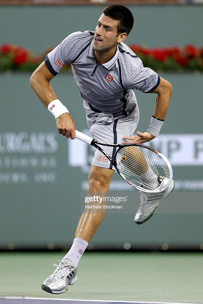 <a gi-track='captionPersonalityLinkClicked' href=/galleries/search?phrase=Novak+Djokovic&family=editorial&specificpeople=588315 ng-click='$event.stopPropagation()'>Novak Djokovic</a> of Serbia serves to Sam Querrey during the BNP Paribas Open at the Indian Wells Tennis Garden on March 13, 2013 in Indian Wells, California.