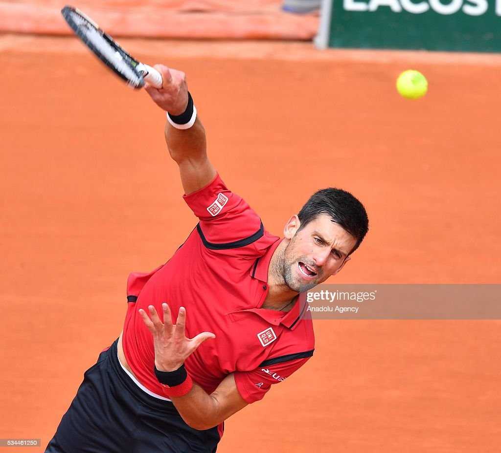 Novak Djokovic of Serbia serves to Steve Darcis (not seen) of Belgium during their men's single second round match at the French Open tennis tournament at Roland Garros in Paris, France on May 26, 2016.