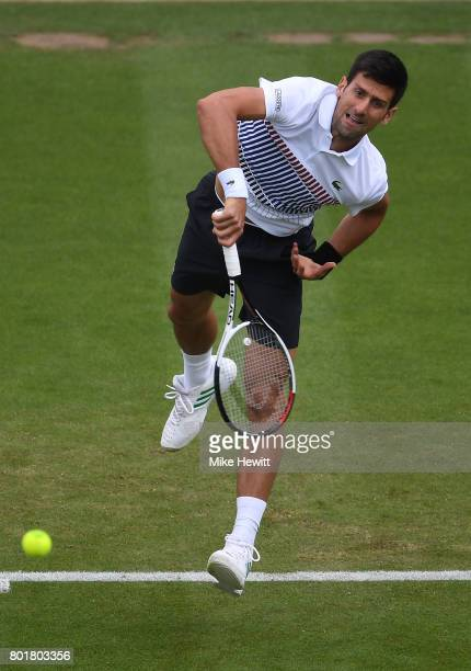 Novak Djokovic of Serbia serves to Vasek Pospisil of Canada during Day 3 of the Aegon International Eastbourne tournament at Devonshire Park on June...