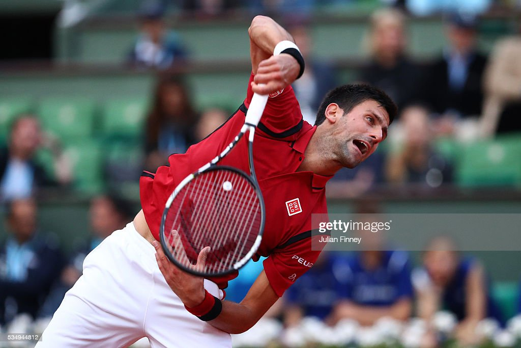 Novak Djokovic of Serbia servesl during the Men's Singles third round match against Aljaz Bedene of Great Britain on day seven of the 2016 French Open at Roland Garros on May 28, 2016 in Paris, France.