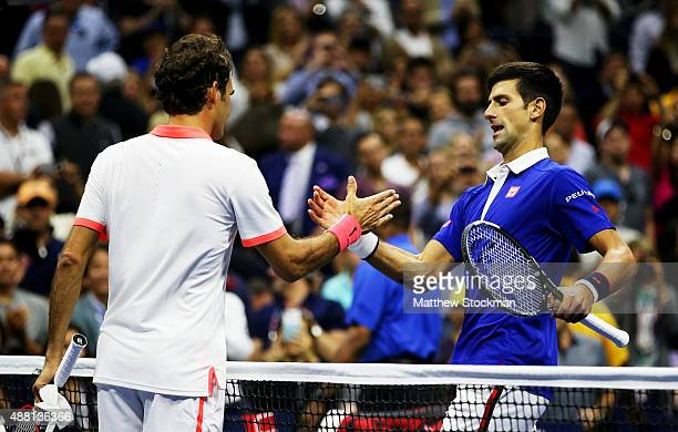Novak Djokovic of Serbia shakes hand with Roger Federer of Switzerland after their Men's Singles Final match on Day Fourteen of the 2015 US Open at...