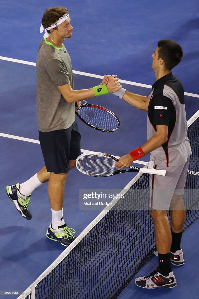 Novak Djokovic (R) of Serbia shakes hands after his win in his third round match against Denis Istomin of Uzbekistan during day five of the 2014 Australian Open at Melbourne Park on January 17, 2014 in Melbourne, Australia.