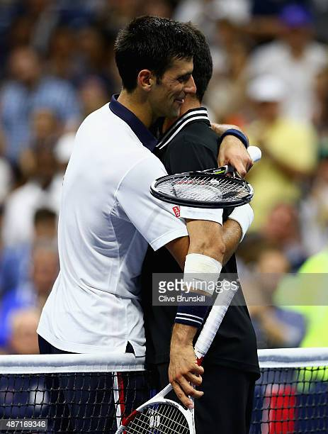 Novak Djokovic of Serbia shakes hands at the net after his four set victory against Roberto Bautista Agut of Spain in their mens singles fourth round...