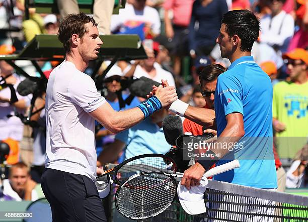 Novak Djokovic of Serbia shakes hands at the net after his three set victory against Andy Murray of Great Britain in the mens final during the Miami...