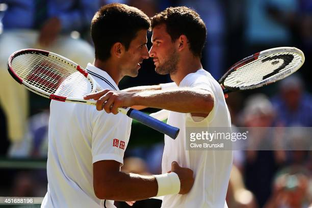 Novak Djokovic of Serbia shakes hands with Grigor Dimitrov of Bulgaria after winning their Gentlemen's Singles semifinal match on day eleven of the...