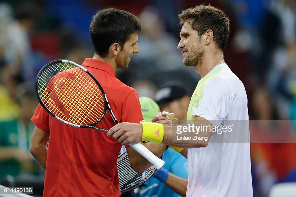 Novak Djokovic of Serbia shakes hands with Mischa Zverev of Germany during day six of Shanghai Rolex Masters at Qi Zhong Tennis Centre on October 14...
