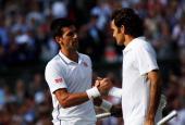 Novak Djokovic of Serbia shakes hands with Roger Federer of Switzerland after their Gentlemen's Singles Final match on day thirteen of the Wimbledon...