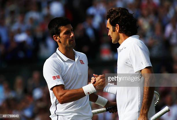Novak Djokovic of Serbia shakes hands with Roger Federer of Switzerland after their Gentlemen's Singles Final match on day thirteen of the Wimbledon...