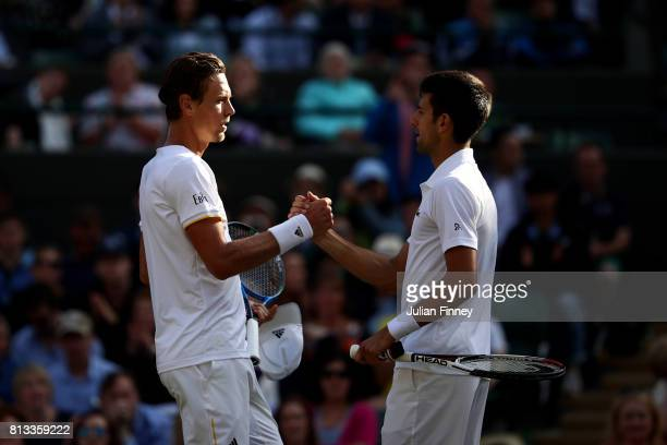Novak Djokovic of Serbia shakes hands with Tomas Berdych of The Czech Republic as he retires injured during the Gentlemen's Singles quarter final...