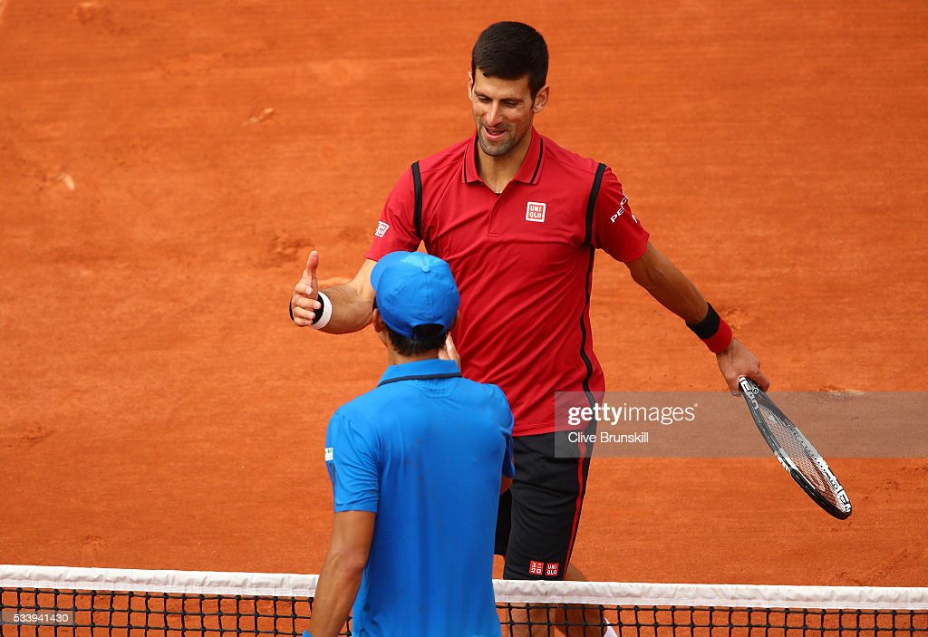 <a gi-track='captionPersonalityLinkClicked' href=/galleries/search?phrase=Novak+Djokovic&family=editorial&specificpeople=588315 ng-click='$event.stopPropagation()'>Novak Djokovic</a> of Serbia shakes hands with <a gi-track='captionPersonalityLinkClicked' href=/galleries/search?phrase=Yen-Hsun+Lu&family=editorial&specificpeople=584941 ng-click='$event.stopPropagation()'>Yen-Hsun Lu</a> of Taipei following the Men's Singles first round match on day three of the 2016 French Open at Roland Garros on May 24, 2016 in Paris, France.