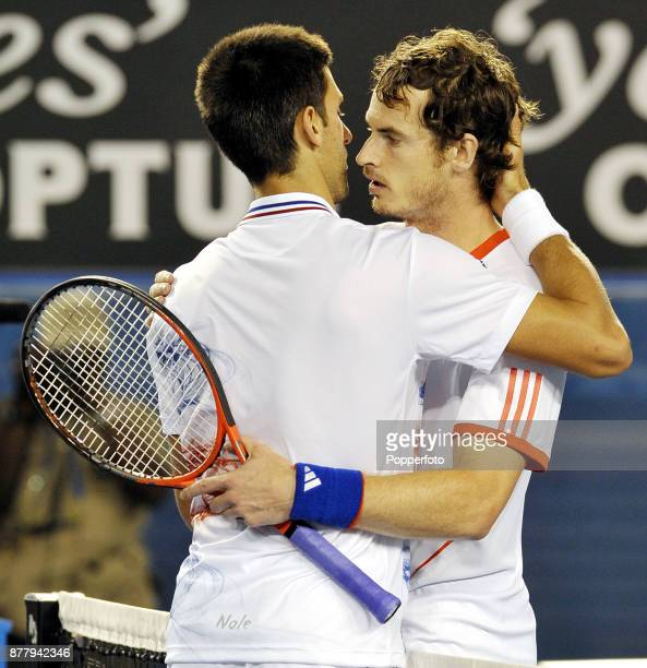 Novak Djokovic of Serbia shares a warm embrace with Andy Murray of Great Britain after winning his men's singles semi final in five sets against on...