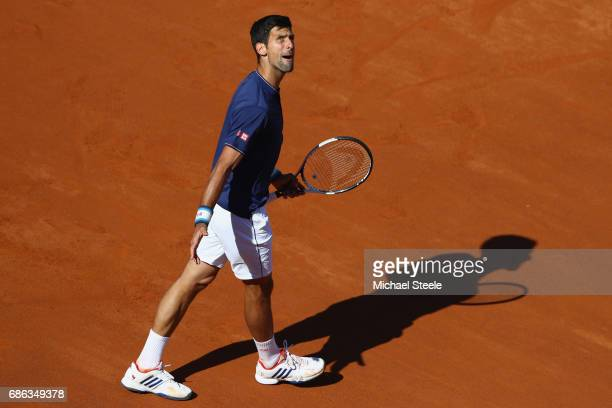 Novak Djokovic of Serbia shows his frustration as he heads to a straight sets defeat during the men's Final against Alexander Zverev of Germany on...