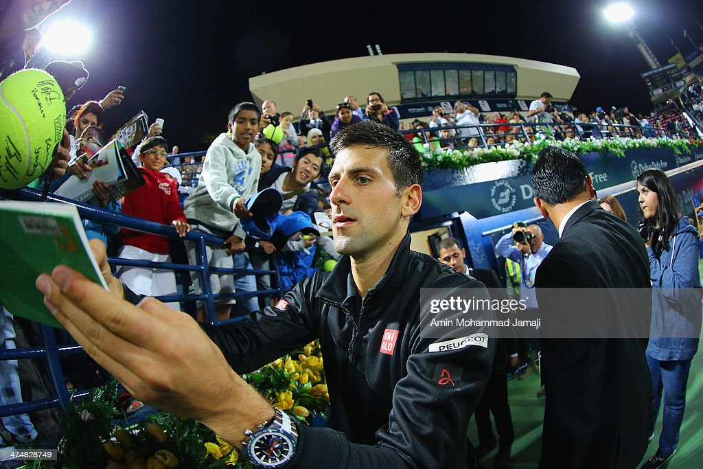 Novak Djokovic of Serbia signs autographs for fans after his first match against Denis Istomin of Uzbekistan on day 2 of the Dubai Duty Free Tennis ATP Championships on February 25, in Dubai, United Arab Emirates.