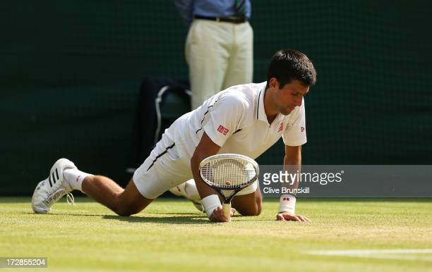 Novak Djokovic of Serbia slips on the grass during the Gentlemen's Singles semifinal match against Juan Martin Del Potro of Argentina on day eleven...