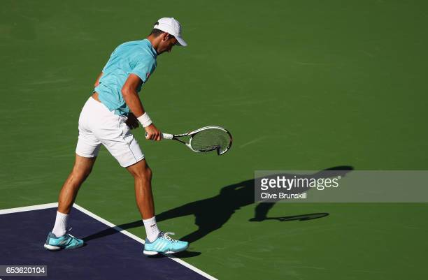 Novak Djokovic of Serbia smashes his racket during his straight set defeat by Nick Kyrgios of Australia in their fourth round match during day ten of...