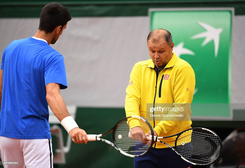 <a gi-track='captionPersonalityLinkClicked' href=/galleries/search?phrase=Novak+Djokovic&family=editorial&specificpeople=588315 ng-click='$event.stopPropagation()'>Novak Djokovic</a> of Serbia speaks with coach Marian Vajda during a training session on day fourteen of the 2016 French Open at Roland Garros on June 4, 2016 in Paris, France.