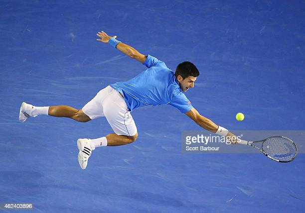 Novak Djokovic of Serbia stretches for a backhand in his quarter final match against Milos Raonic of Canada during day 10 of the 2015 Australian Open...