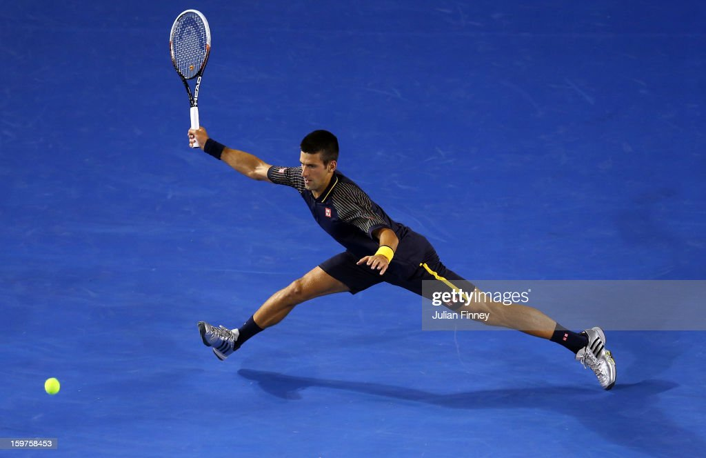Novak Djokovic of Serbia stretches for a forehand in his fourth round match against Stanislas Wawrinka of Switzerland during day seven of the 2013 Australian Open at Melbourne Park on January 20, 2013 in Melbourne, Australia