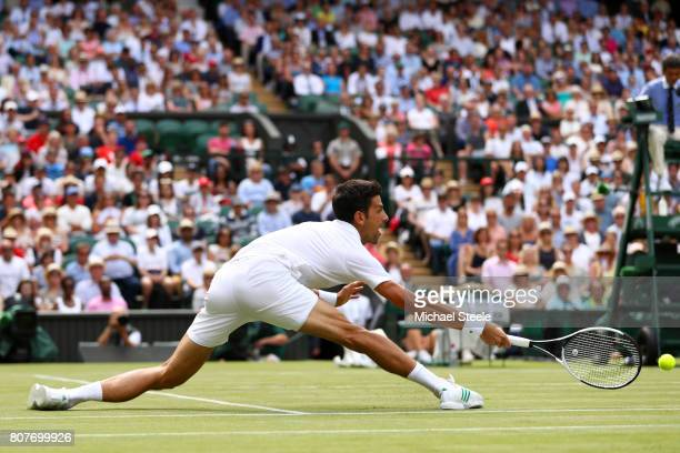 Novak Djokovic of Serbia stretches for the ball during the Gentlemen's Singles first round match against Martin Klizan of Slovakia on day two of the...