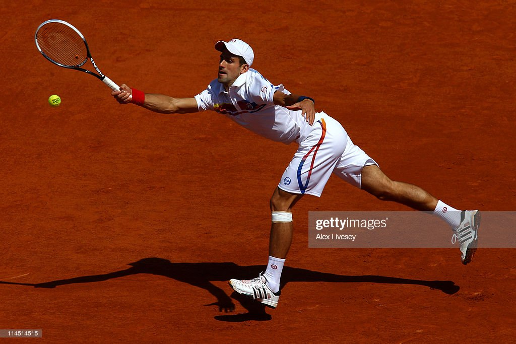 Novak Djokovic of Serbia stretches to hit a forehand during the men's singles first round match between Thiemo De Bakker of Netherlands and Novak Djokovic of Serbia on day two of the French Open at Roland Garros on May 23, 2011 in Paris, France.
