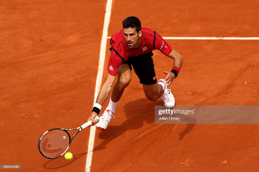 <a gi-track='captionPersonalityLinkClicked' href=/galleries/search?phrase=Novak+Djokovic&family=editorial&specificpeople=588315 ng-click='$event.stopPropagation()'>Novak Djokovic</a> of Serbia stretches to hit a forehand during the Men's Singles second round match against Steve Darcis of Belgium on day five of the 2016 French Open at Roland Garros on May 26, 2016 in Paris, France.