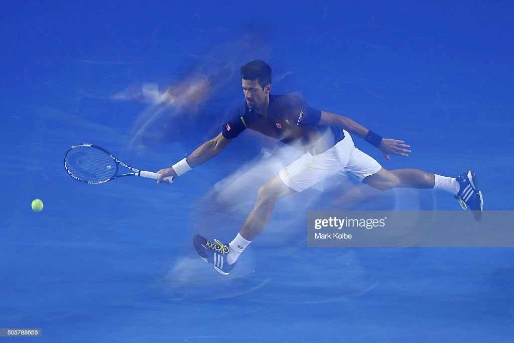 Novak Djokovic of Serbia stretches to play a forehand in his second round match against Quentin Halys of France during day three of the 2016 Australian Open at Melbourne Park on January 20, 2016 in Melbourne, Australia.