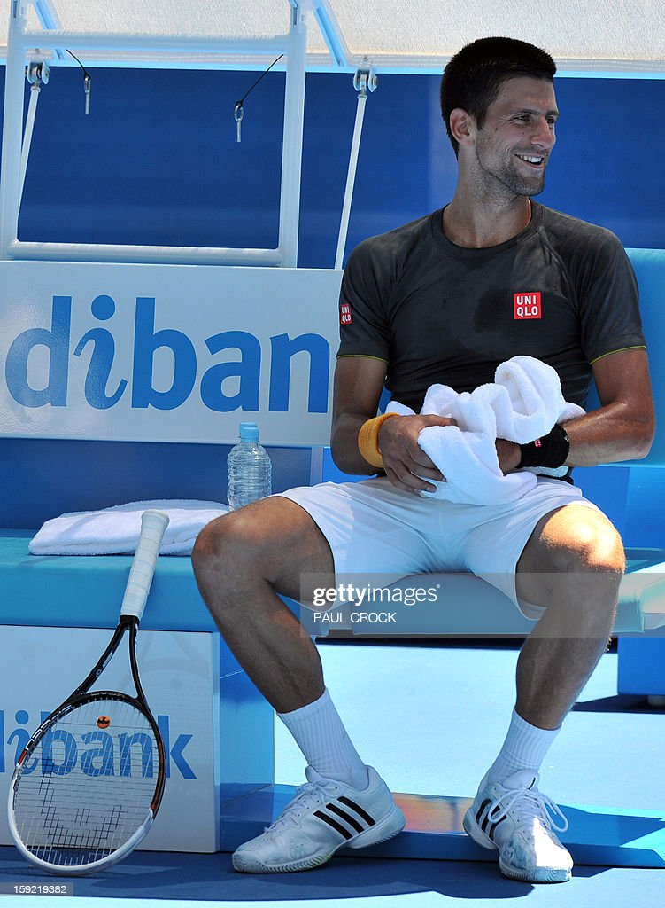 Novak Djokovic of Serbia takes a break during a practice session for the upcoming Australian Open tennis tournament in Melbourne on January 10, 2013. The first Grand Slam tennis tournament of the year is set to run from January 14 to 27. AFP PHOTO / Paul CROCK IMAGE