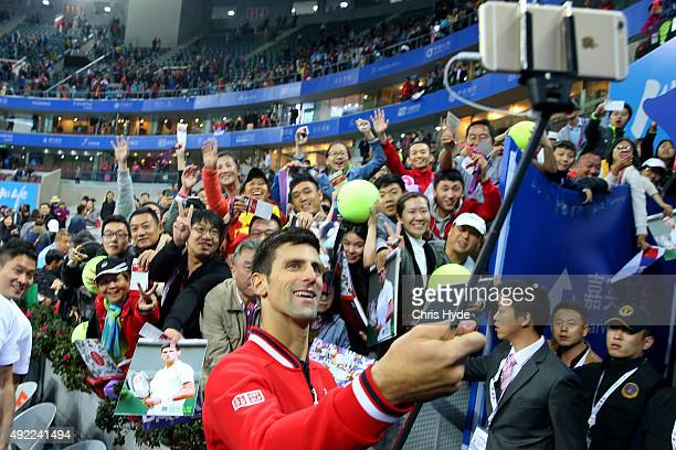 Novak Djokovic of Serbia takes a selfie after winning the Mens final against Rafael Nadal of Spain on day 9 of the 2015 China Open at the China...