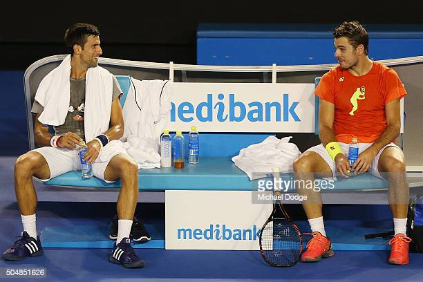 Novak Djokovic of Serbia talks with Stan Wawrinka of Switzerland during a practice session ahead of the 2016 Australian Open at Melbourne Park on...