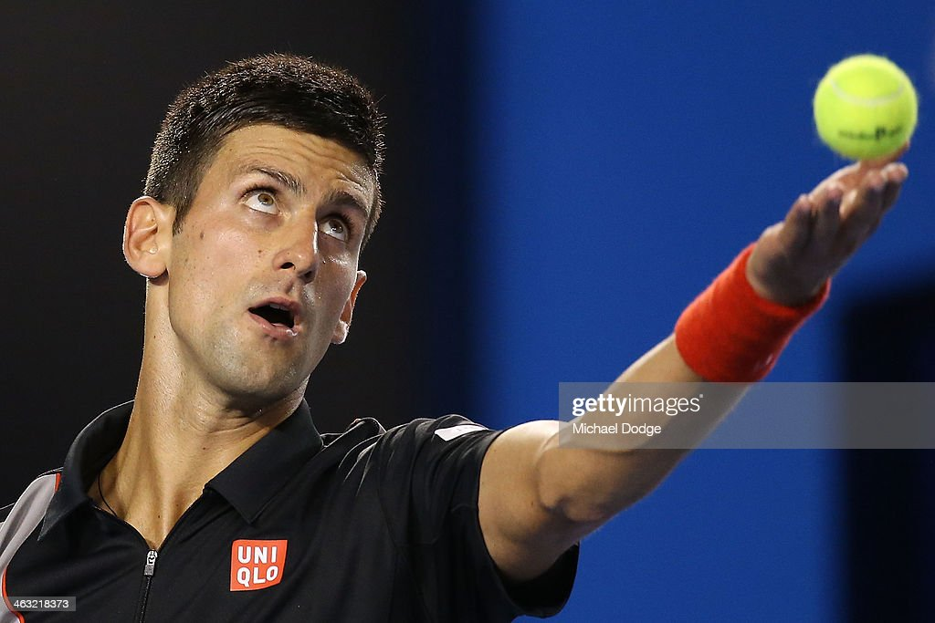 Novak Djokovic of Serbia tosses the ball up to serve in his third round match against Denis Istomin of Uzbekistan during day five of the 2014 Australian Open at Melbourne Park on January 17, 2014 in Melbourne, Australia.