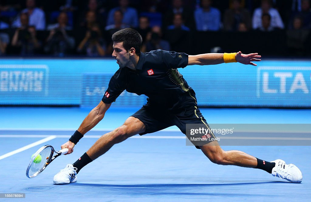 Novak Djokovic of Serbia volleys during the men's singles match against Jo-Wilfried Tsonga of France on day one of the ATP World Tour Finals at the O2 Arena on November 5, 2012 in London, England.
