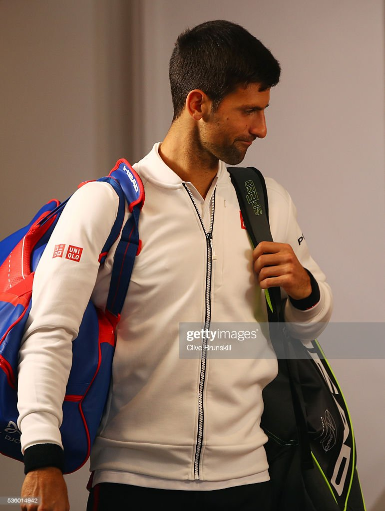 <a gi-track='captionPersonalityLinkClicked' href=/galleries/search?phrase=Novak+Djokovic&family=editorial&specificpeople=588315 ng-click='$event.stopPropagation()'>Novak Djokovic</a> of Serbia walks back onto court following a rain delay during the Men's Singles fourth round match against Roberto Bautista Agut of Spain on day ten of the 2016 French Open at Roland Garros on May 31, 2016 in Paris, France.