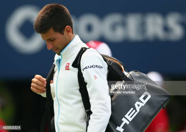 Novak Djokovic of Serbia walks off the court after a loss against JoWilfried Tsonga of France during Rogers Cup at Rexall Centre at York University...