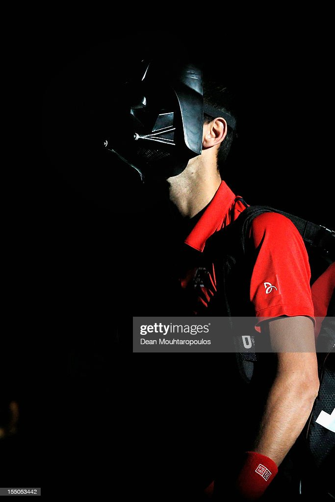 Novak Djokovic of Serbia walks on the court wearing a Darth Vader mask for Halloween to play against Sam Querrey of USA during day 3 of the BNP Paribas Masters at Palais Omnisports de Bercy on October 31, 2012 in Paris, France.