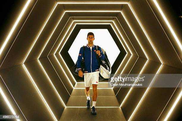 Novak Djokovic of Serbia walks out to play his match against Tomas Berdych of Czech Republic during Day 5 of the BNP Paribas Masters held at...
