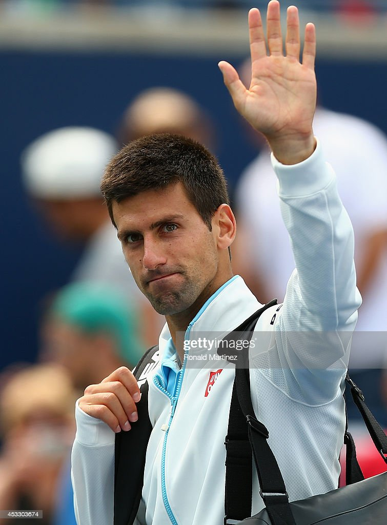 <a gi-track='captionPersonalityLinkClicked' href=/galleries/search?phrase=Novak+Djokovic&family=editorial&specificpeople=588315 ng-click='$event.stopPropagation()'>Novak Djokovic</a> of Serbia waves as he walks off the court after a loss against Jo-Wilfried Tsonga of France during Rogers Cup at Rexall Centre at York University on August 7, 2014 in Toronto, Canada.
