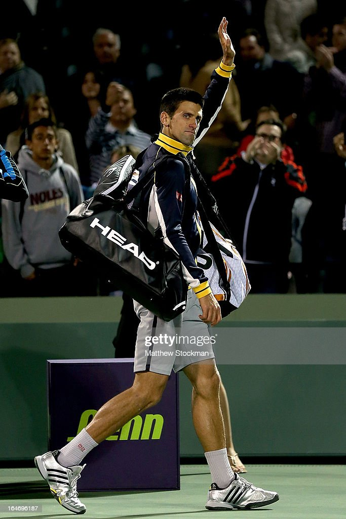 <a gi-track='captionPersonalityLinkClicked' href=/galleries/search?phrase=Novak+Djokovic&family=editorial&specificpeople=588315 ng-click='$event.stopPropagation()'>Novak Djokovic</a> of Serbia waves to the crowd as he leaves the court after losing to Tommy Haas of Germany during the Sony Open at Crandon Park Tennis Center on March 26, 2013 in Key Biscayne, Florida.