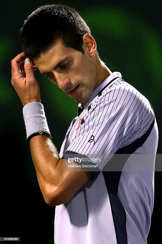 Novak Djokovic of Serbia wipes his forehead between points while playing Tommy Haas of Germany during the Sony Open at Crandon Park Tennis Center on March 26, 2013 in Key Biscayne, Florida.