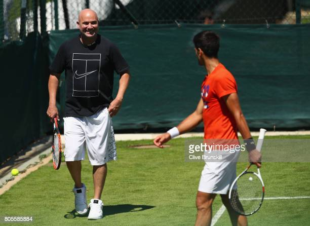 Novak Djokovic of Serbia with his coach Andre Agassi during practice ahead of the Wimbledon Lawn Tennis Championships at the All England Lawn Tennis...