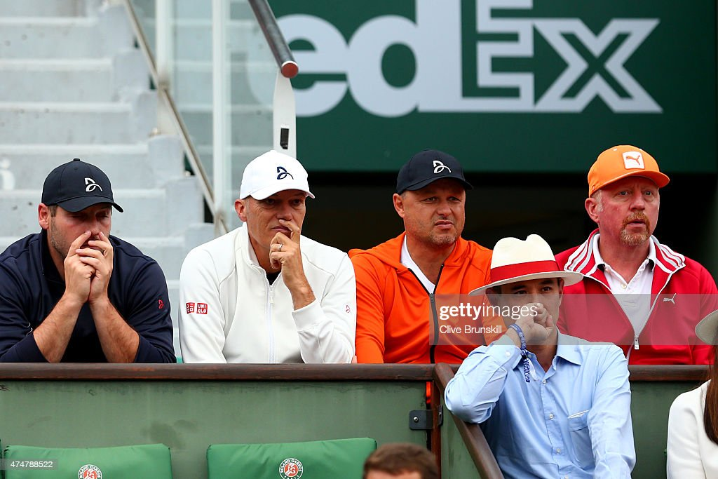 Novak Djokovic of Serbia's coach <a gi-track='captionPersonalityLinkClicked' href=/galleries/search?phrase=Boris+Becker&family=editorial&specificpeople=67204 ng-click='$event.stopPropagation()'>Boris Becker</a> (R) sits with members of his team including Milan Amanovic (L), Gebhard Phil-Gritsch (2nd L) and Marian Vajda (2nd R) as they watch his Men's Singles match against Jarkko Nieminen of Finland on day three of the 2015 French Open at Roland Garros on May 26, 2015 in Paris, France.