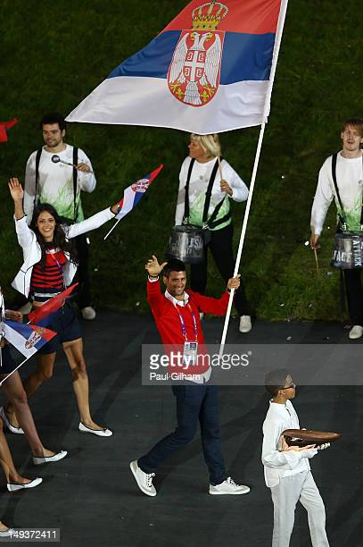 Novak Djokovic of the Serbia Olympic tennis team carries his country's flag during the Opening Ceremony of the London 2012 Olympic Games at the...