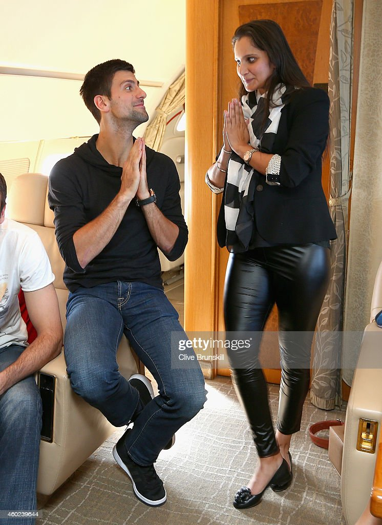 Novak Djokovic of the UAE Royals has fun with Sania Mirza of the Indian Aces during the private players flight from Delhi,India to Dubai prior to the Coca-Cola International Premier Tennis League fourth leg at the Hamdan Sports Complex, December 10, 2014 in Dubai.